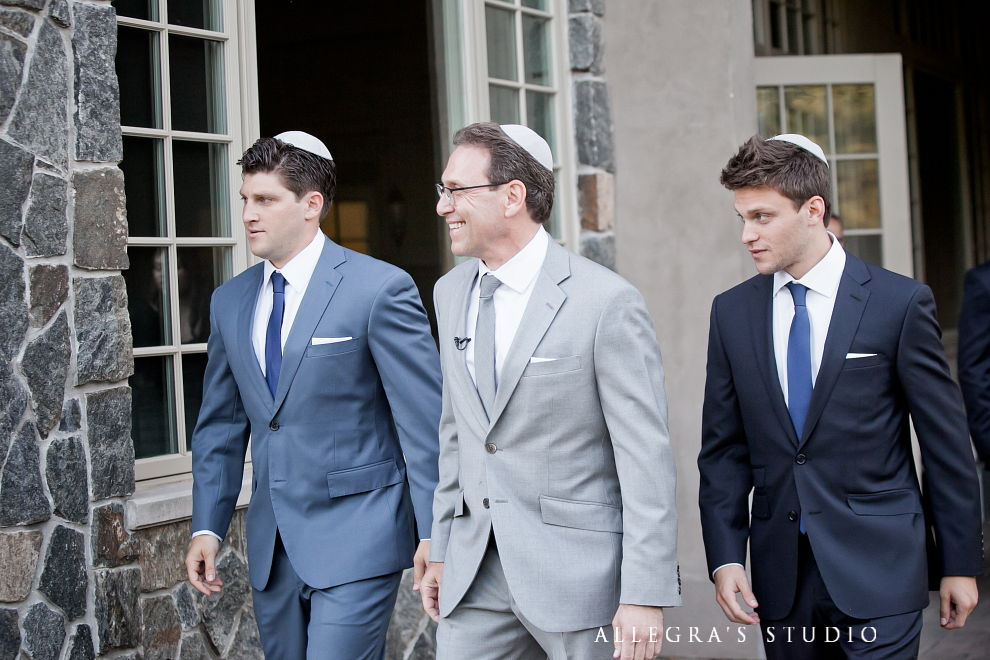 groom walks down aisle with his sons
