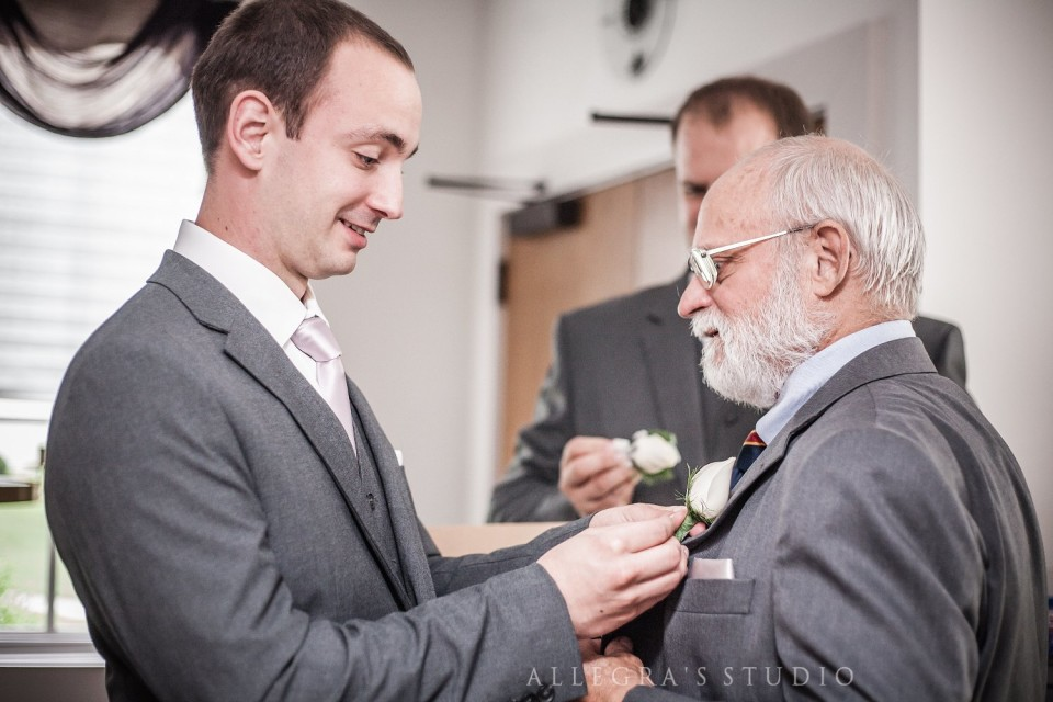 Groom pins boutonnière on Dad