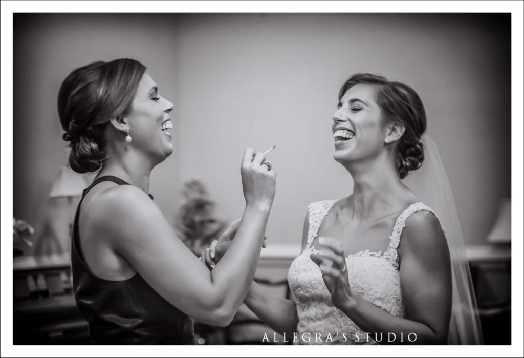 Bride laughing with her sister