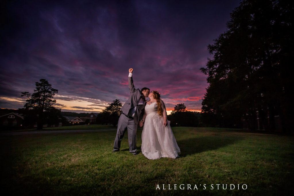married! wedding couple with sunset at sweet briar college