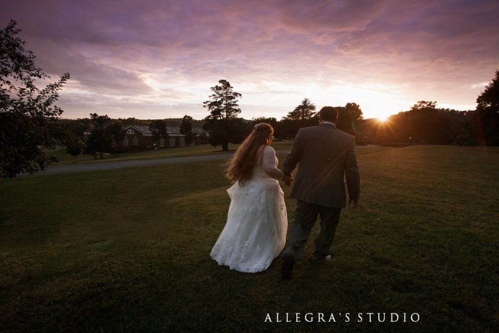 wedding couple into the sunset at sweet briar college