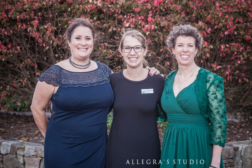 Rhiannon Ham, coordinator at Wintergreen weddings with two happy brides